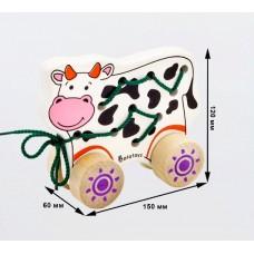 Деревянная каталка - шнуровка  Корова 15x12x6 см